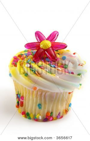 Cupcake With Flower And Sprinkles Decorations