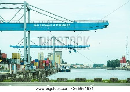 Strasbourg, France - May 10, 2020: Working Port Autonome De Strasbourg With Cargo Container Ship Wor