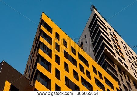 Yellow Ventilated Facade With Windows. A Fragment Of A New Modern Luxury Residential Building Or Com