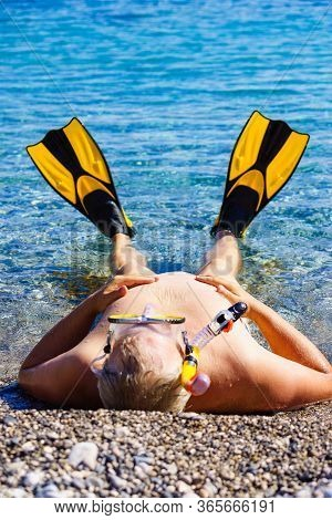 Mature Man With Snorkel Equipment Flippers And Snorkeling Mask Tube On Beach Sea Shore. Summer Vacat