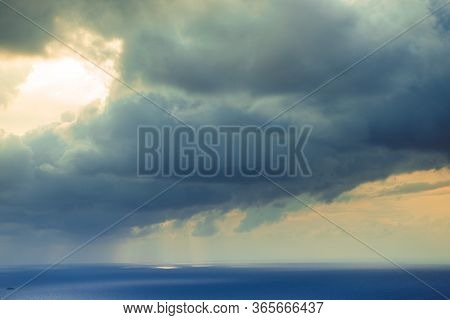 Skyscape Or Cloudscape. Overcast Evening Sky With Stormy Dark Clouds Moving Over Sea Surface. Weathe