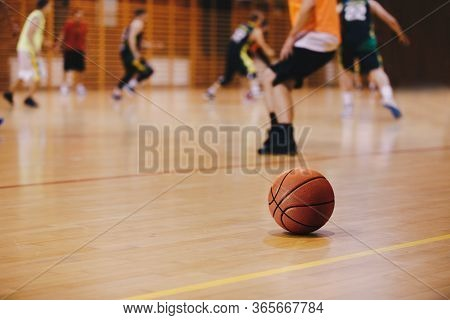 Basketball Training Session. Basketball Game Background. Basketball On Wooden Court Floor Close Up W