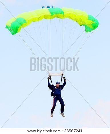 PILSEN, CZECH REPUBLIC - AUGUST 25: Unidentified skydiver flying on a swooping parachute. Member of a parachute acrobatic team. Pilsen Aeronautical Days on August 25, 2012 in Pilsen, Czech Republic.