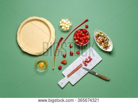 Above View With The Ingredients And The Dough For A Fruitcake. Homemade Pie Making Of. Strawberry An