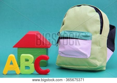 Abc - Letters Of The English Alphabet To The Will Of A Wooden House And A School Bag. Back To School