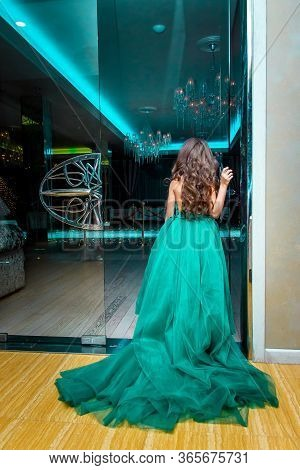 Girl In A Turquoise Dress Stands At The Entrance To The Festive Hall