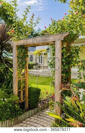 Cape Town, South Africa - February 6, 2020: Garden Archway In Upmarket Wealthy Suburban Mansion Hous