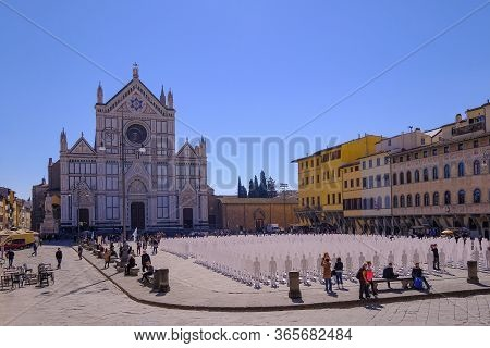 Florence, Tuscany, Italy, March 30, 2019: Tourists On The Square In Front Of The Basilica Di Santa C