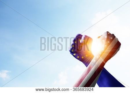 Usa Flag And Eu Flag Print Screen Fists And Wrestling With Blue Sky And Sunlight. United States Of A