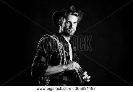 Western Culture. Man Wearing Hat Hold Rope And Flask. Lasso Tool Of American Cowboy. Sheriff Concept