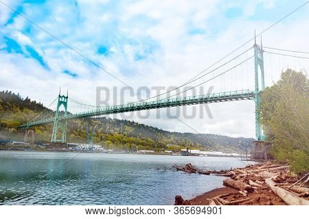 Willamette River And St. Johns Bridge In Portland The Steel Suspension Construction With Dual Gothic
