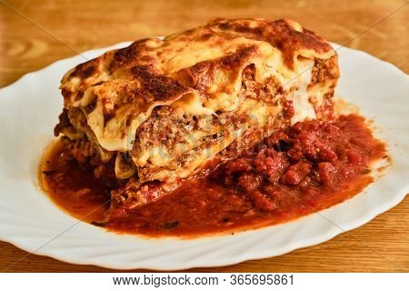 Tasty Lasagne Bolognese With Minced Meat On White Plate
