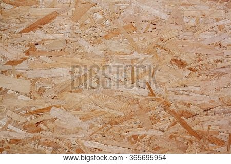 Osb Plate Texture. Hardboard Wood Texture. The Structure Of The Pressed Wood Chipboard.