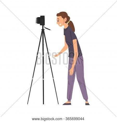 Female Video Operator Looking Through Camcorder On Tripod, Videographer With Professional Equipment