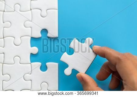 Jigsaw Connection Between White  Jigsaw Puzzles, Jigsaw Puzzle In The Hand Of A Businessman,  Busine
