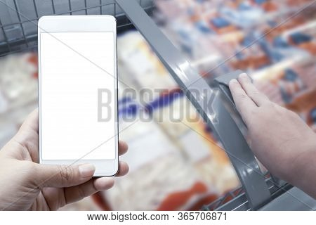 Online Order Grocery Shopping On Touch Screen Concept. Woman Hand Holding Smart Phone For Delivery S