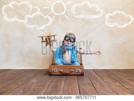 Happy Child Playing With Vintage Wooden Airplane