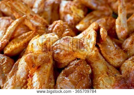 Chicken Wings In A Marinade. Close-up Photo. Cooking Chicken With Spices In The Oven. Grilled Chicke