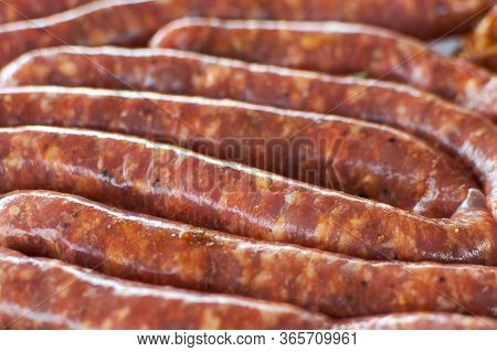 Sausages For Barbecue. Fresh Raw Sausages For Grilling. Pork Sausages. Fresh Minced Meat In The Gut.