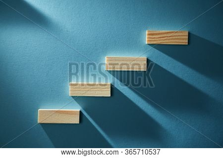Career Development. Step By Step. Goal Achievement Concept. Wooden Stairs Symbolize Growth. Increasi