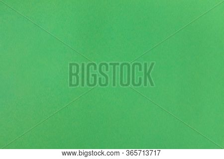 Recycled Green Color Paper Texture Background. Green Old Textured Cardboard Sheet Background. Grass