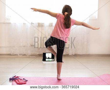 Fitness Workout At Home Watching Videos Online Working On Laptop Computer