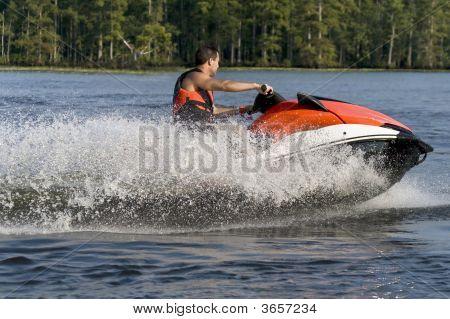 Man Riding Wave Runner