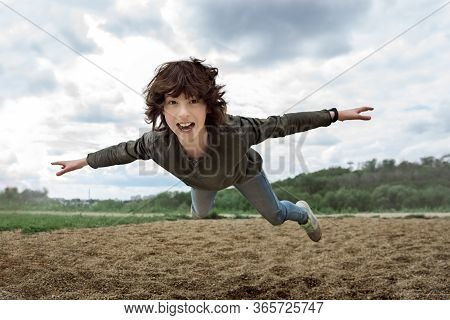 The Joyful Boy In Flight (levitation Effect).