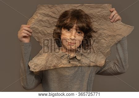 Portrait Of A Boy On Crumpled Paper. Creative Double Exposure Effect.