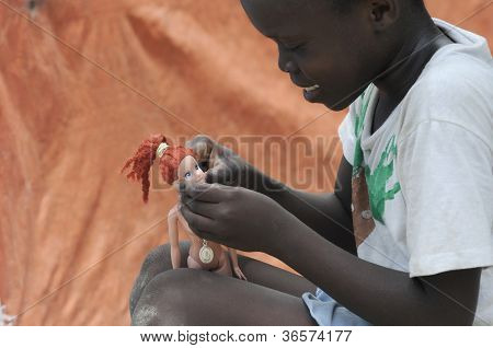 Haitian kid playing with her doll.
