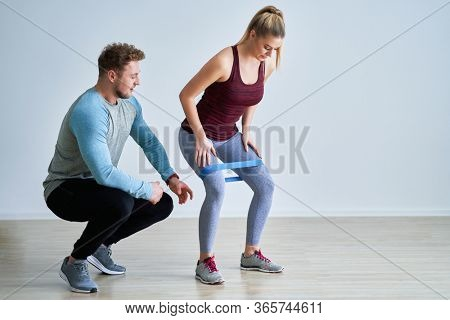 Adult woman training with her personal trainer