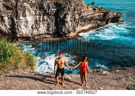 A Couple In Love On The Beach. Beautiful Couple By The Sea On The Island Of Bali. A Single Couple On
