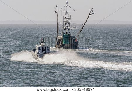 New Bedford, Massachusetts, Usa - May 11, 2020: Massachusetts State Police Patrol Boat Passing Comme