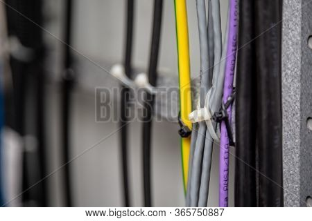 Cables Fastened With White Ties On The Cable Ladder. Black, Gray, Yellow, Purple Wires. Cable Manage