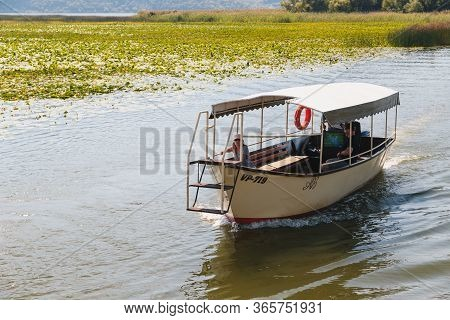 Montenegro, National Park Skadar Lake - September, 21 2018: A Small Boat With Tourists In The Middle