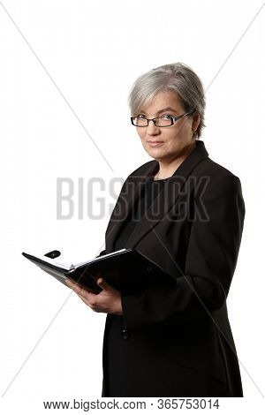 Mature businesswoman holding personal organizer looking at camera, isolated on white background.