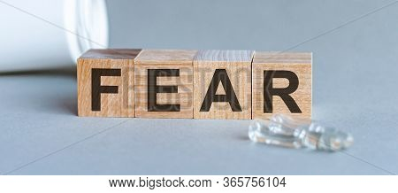 Fear Word Written On Wood Block. Front View. Fear Text On Grey Background For Your Desing, Concept.
