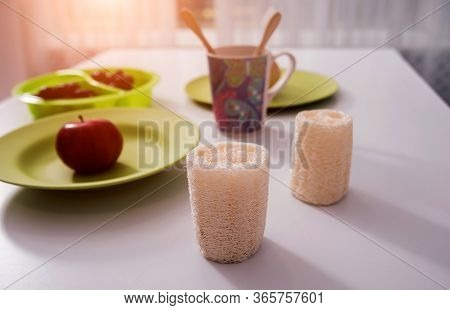 Bamboo Toothbrushes, Washcloths, Cups And Plates On The White Table