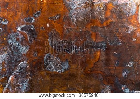 Texture Of Old Oxidated Sheet Of Brass With Colorful Spots And Some Minor Scratches