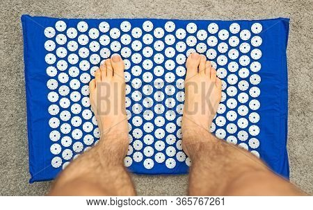 Male Foot On Acupuncture Rug. Alternative China Medicine.