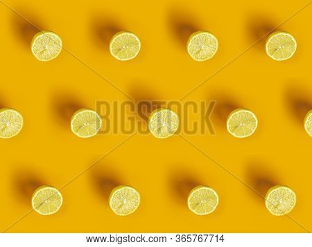 Lemon Frame. Sliced Citruses Pattern On Yellow Background Top.
