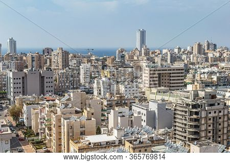 City With High-rise Buildings And Hotels On A Background Of Sky
