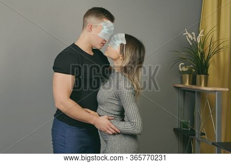 Quarantine During A Pandemic Of Coronavirus Infection Covid-19. A Young Couple Indoors In Self-isola