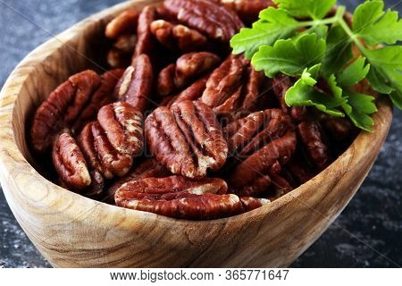 Pecan Nuts On A Rustic Table And Tasty Pecan Nuts In Bowl
