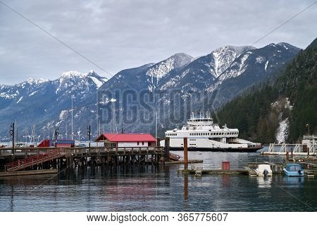 Horseshoe Bay Ferry Terminal Winter. A Bc Ferry Pulls Into The Horseshoe Bay Ferry Terminal In West