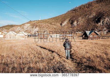 Woman Traveler Traveling At Napa Lake Grassland, Located In Zhongdian City ( Shangri-la). Landmark A