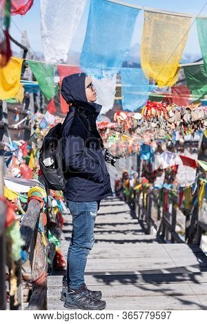 Young Man Traveler With Sweater And Backpack Traveling In Shika Snow Mountain, Happy Asian Hiker Enj