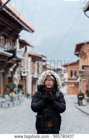 Young Man Traveler With Sweater Traveling In Dukezong Old Town, Located In Zhongdian City (shangri-l