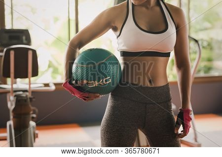 Sport Woman Fit Medicine Ball Training In Gym Room. Sport Relax And Healthy Life In Indoor Or Sport