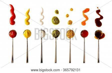 Ketchup, Mustard, Mayonnaise, Basil Pesto, Sweet Chili Sauce And Teriyaki Soy Sauce In Spoon Isolate